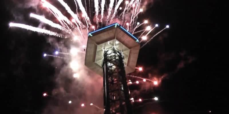 fireworks being shot off from the gatlinburg space needle on new years