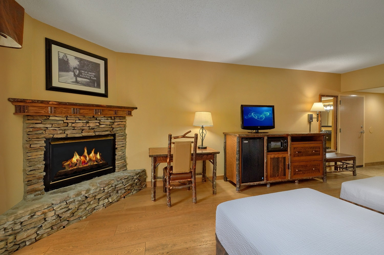 Two queen beds in a room with a fireplace